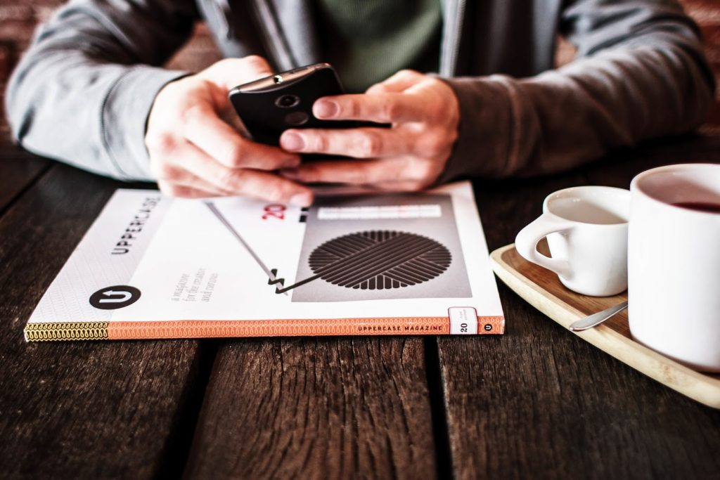 Coffee and Mobile Device Working on Table