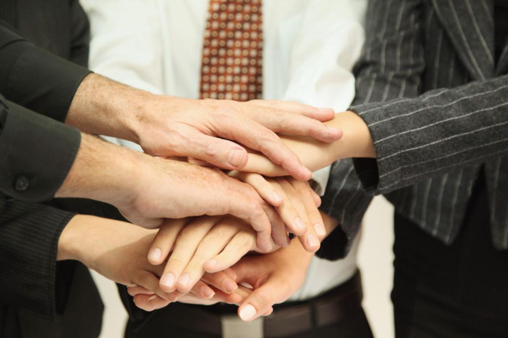 Business-huddle-hands